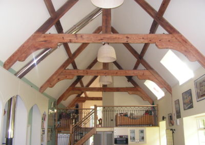 Dwelling with exposed trusses and mezzanine - BHD Partnership